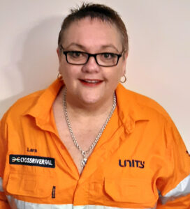 Woman smiling in orange high vis uniform