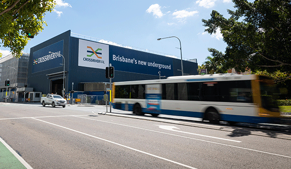 buses and cars driving past the acoustic shed on Roma Street, Brisbane CBD