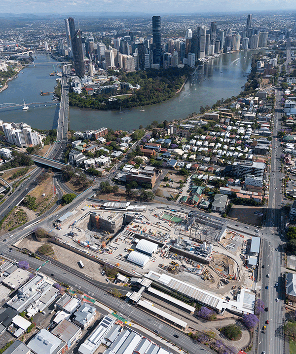Aerial view of Woolloongabba worksite with CBD and river behind