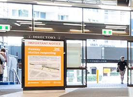 View of the interior of Roma Street station with a sign showing upcoming changes to the site
