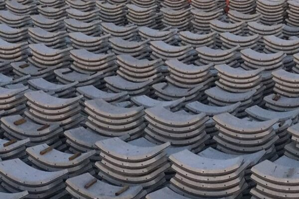 Hundreds of curved concrete segments tacked in pile. It resembles a carpark