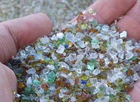 hundreds of tiny colourful glass beads, in a cupped hand