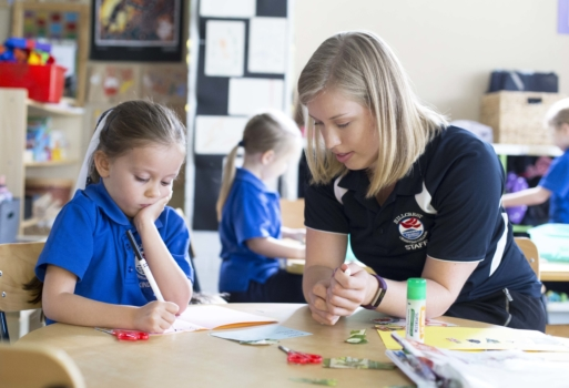 Teacher Working With Kindy Student