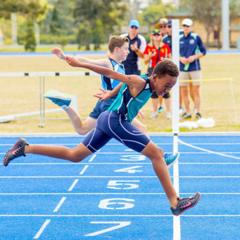 Boy Sprinting Over Line