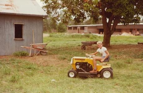 1980 Neil Lewis Mowing Around Mango Tree