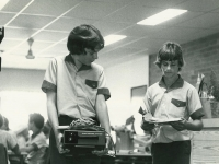 1981 Boys Carry Projector In Library