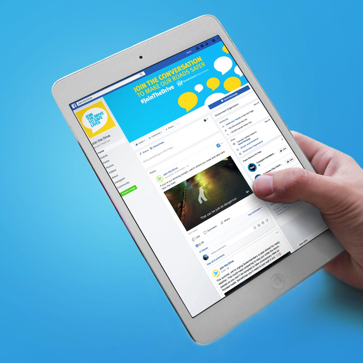 Hand holding an iPad with the Join The Drive website shown