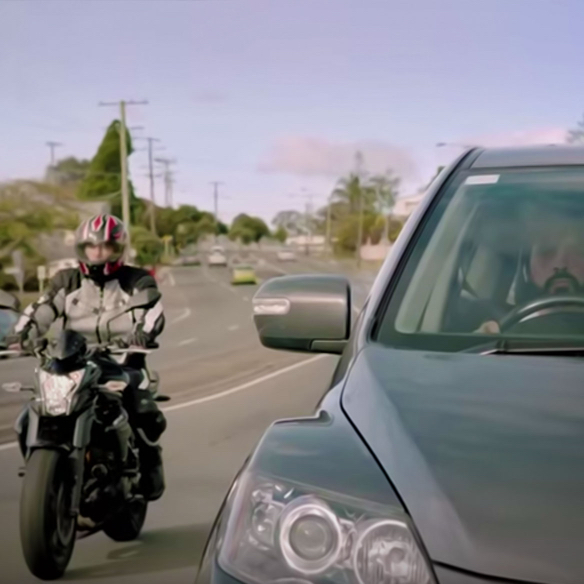 Motorcyclist passing car