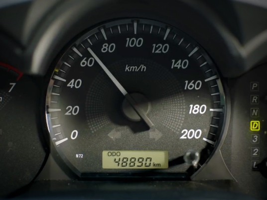 Car speedometer showing 65km/h