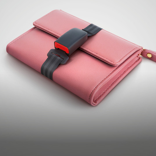 Pink wallet wrapped up in a seatbelt