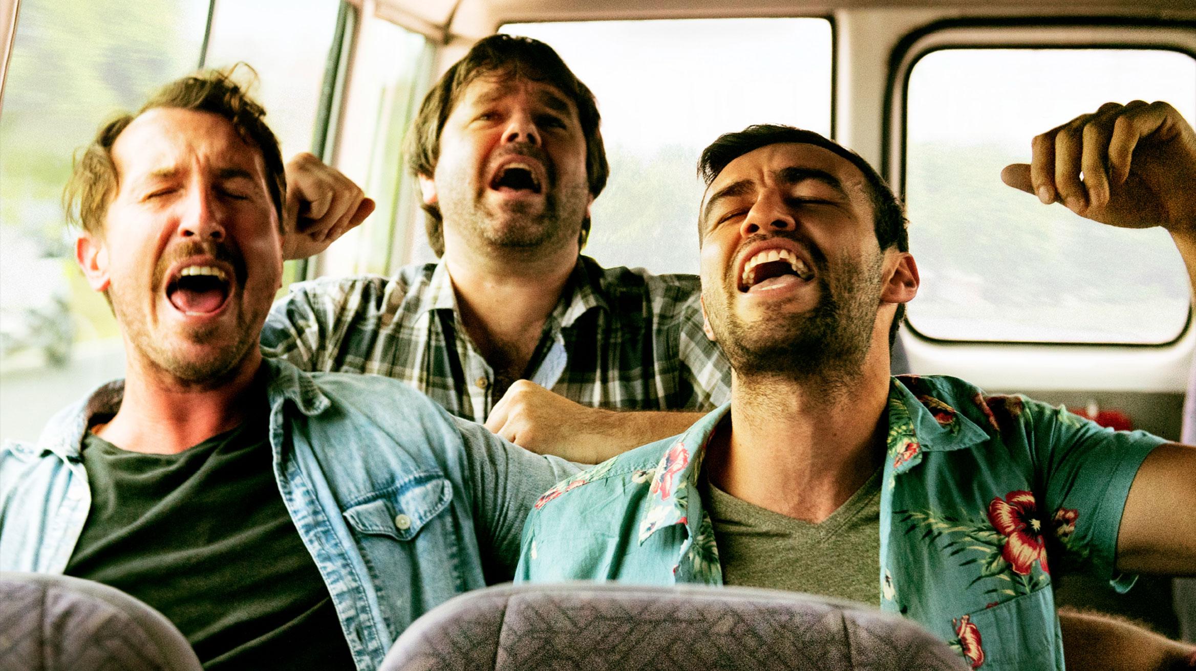 Group of young men singing in a van