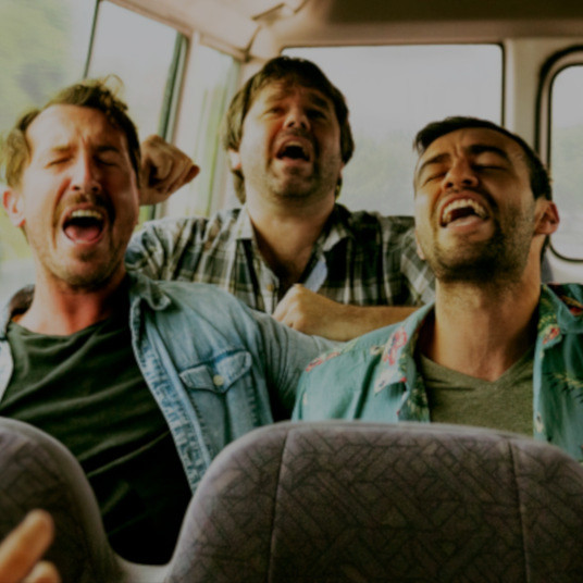 Men singing in a minibus