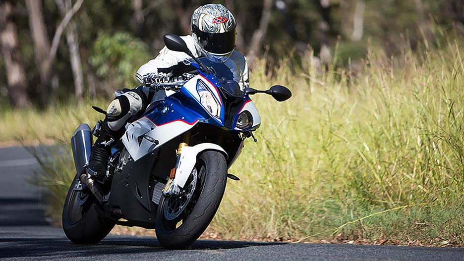 View of BMW motorcycle rider leaned over and taking a corner