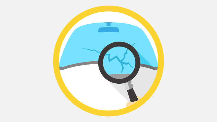 Animation style graphic showing a magnifying glass over a crack in a windscreen.
