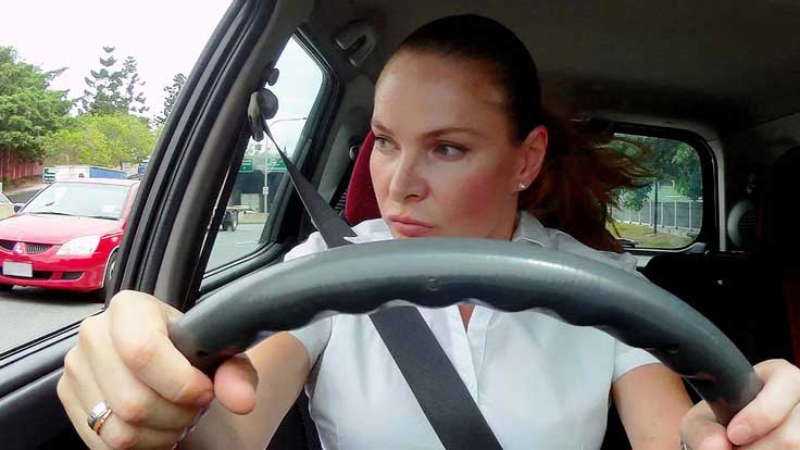 Woman aggressively driving her car