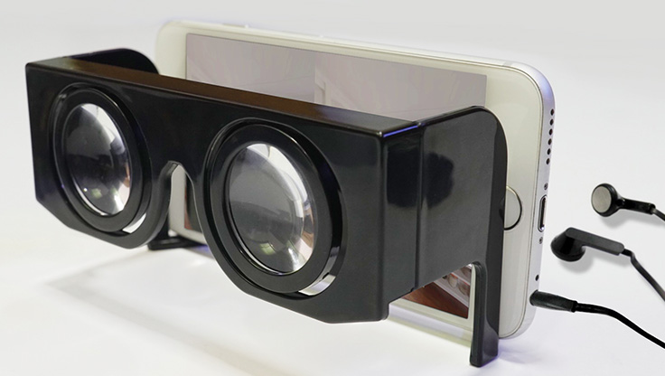 VR goggles a mobile phone and pair of headphones