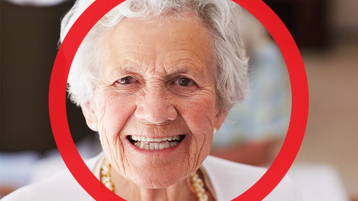 Portrait of older women with a big smile on her face with thick red circle framing her