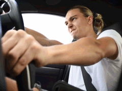Young man with aggressive look on his face clutch a cars gear lever
