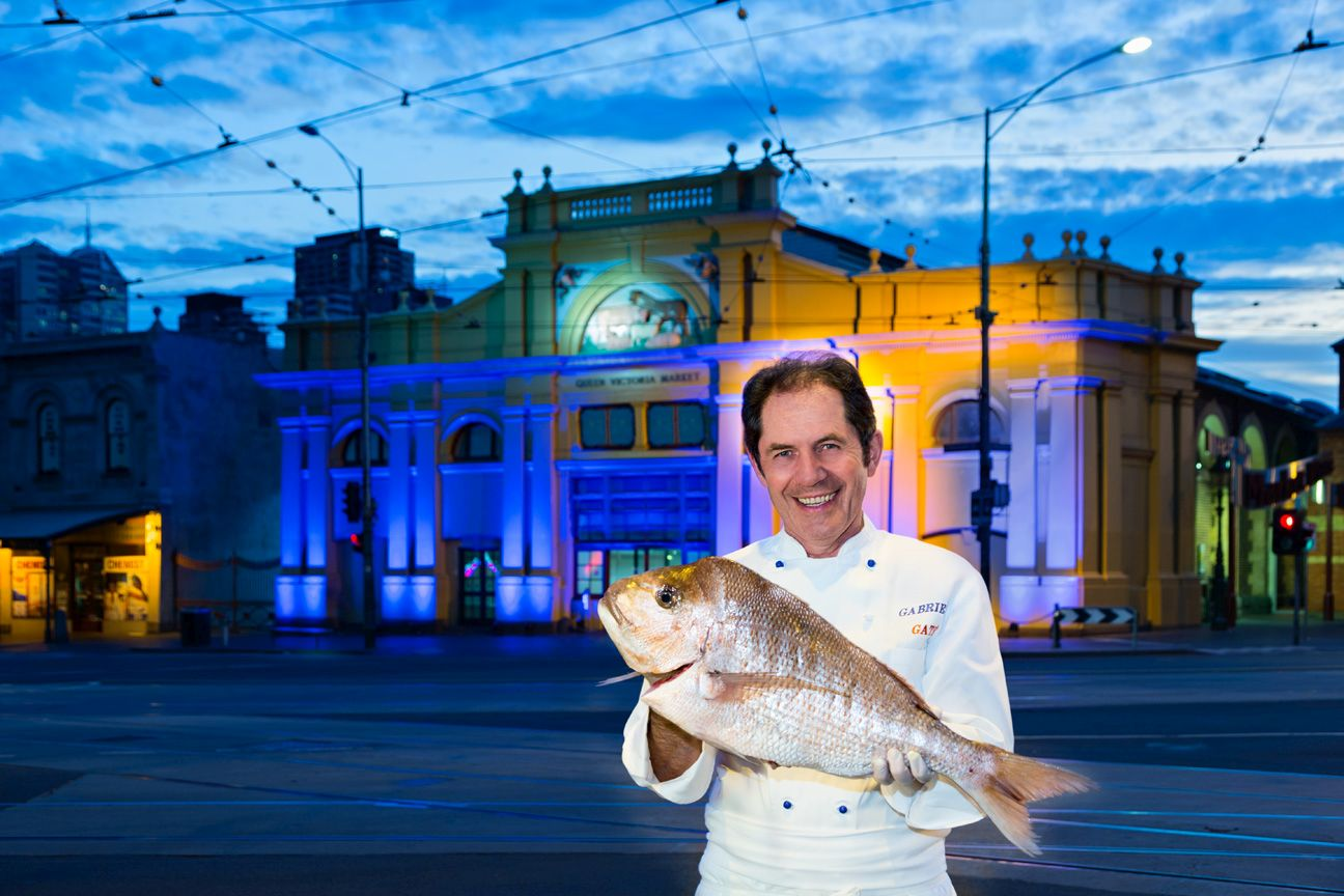 Diabetes Victoria Food Ambassador Gabriel Gate in front of the lit-up Queen Victoria Market promoting the healthy eating message.