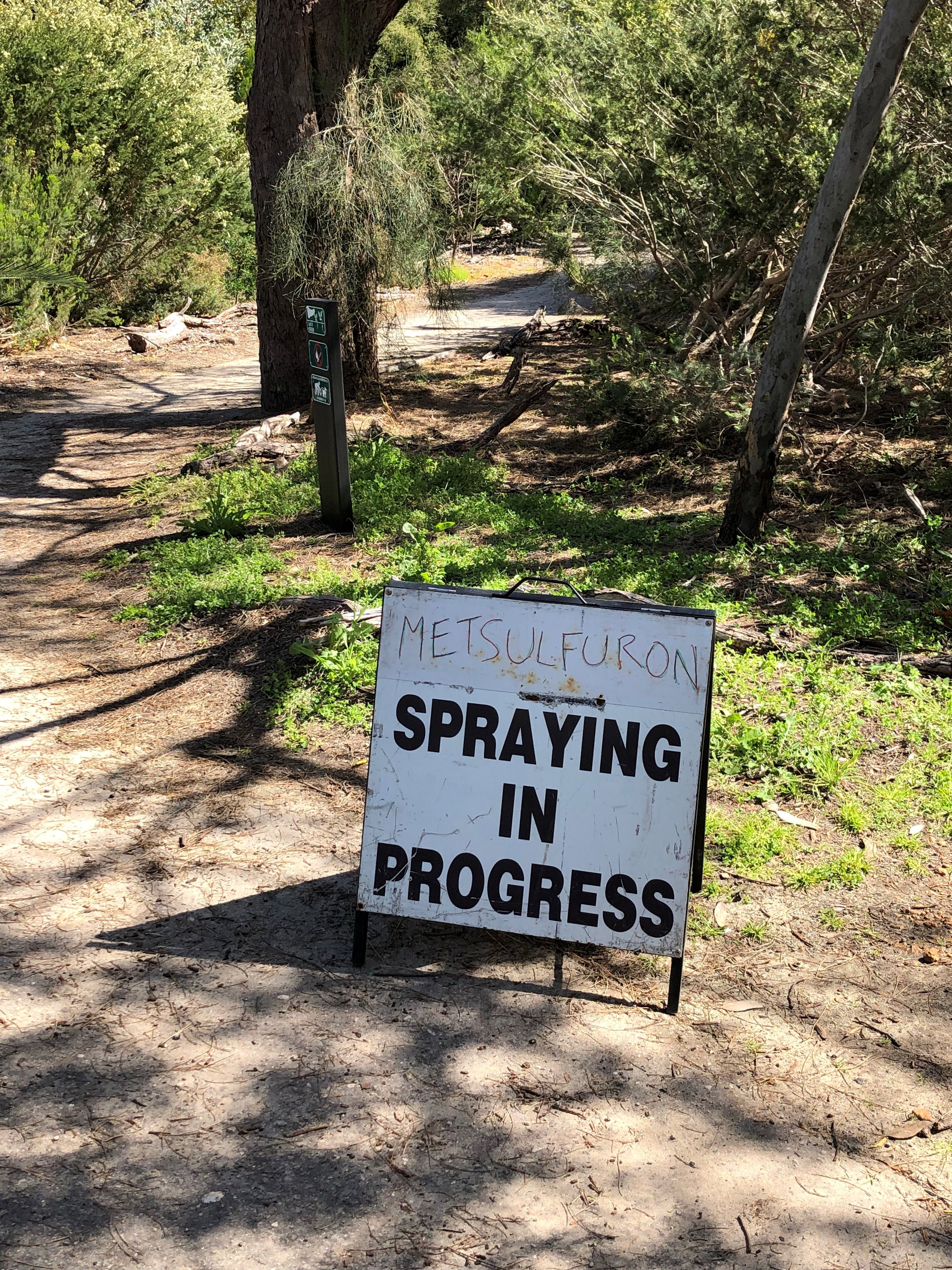 Weed spraying sign in hollywood reserve