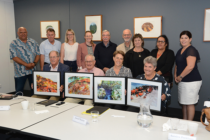 group photo including watercolour prints for 4 members whose term finished February 2020