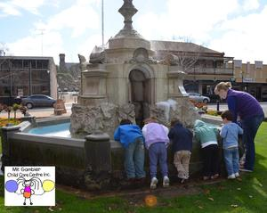 Exploring the fountain next to the town hall.