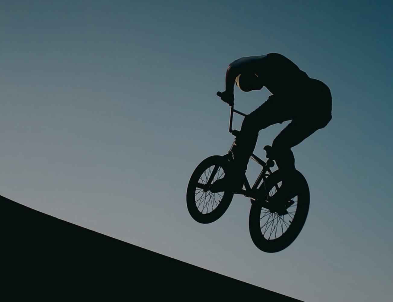 BMX bike rider doing a jump