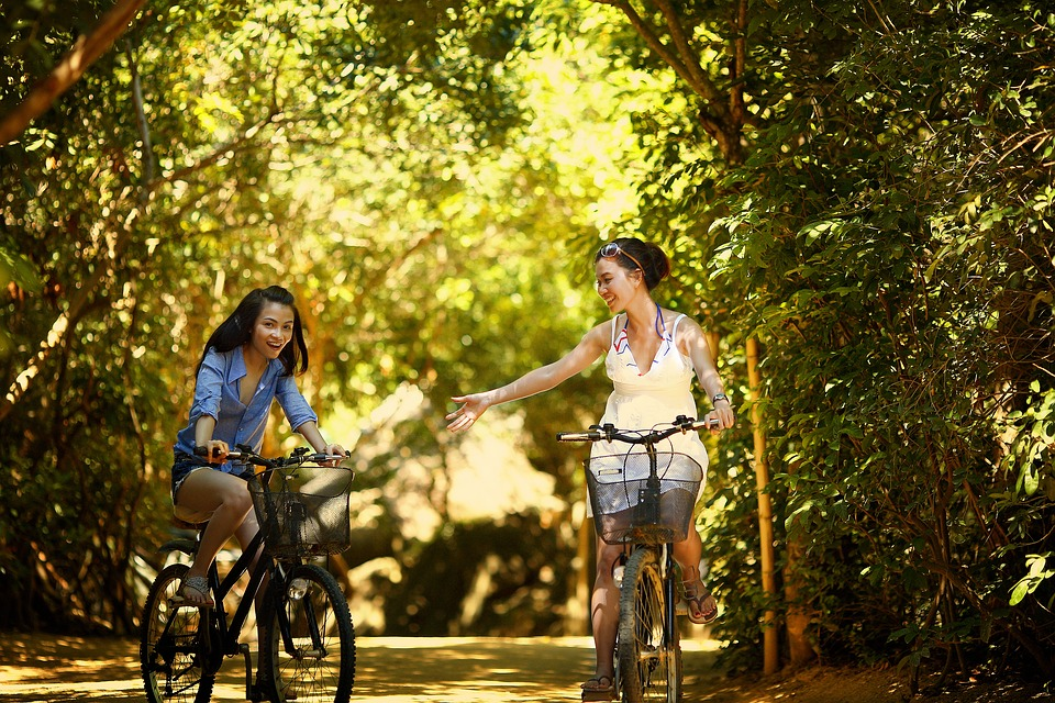Girls cycling for fun