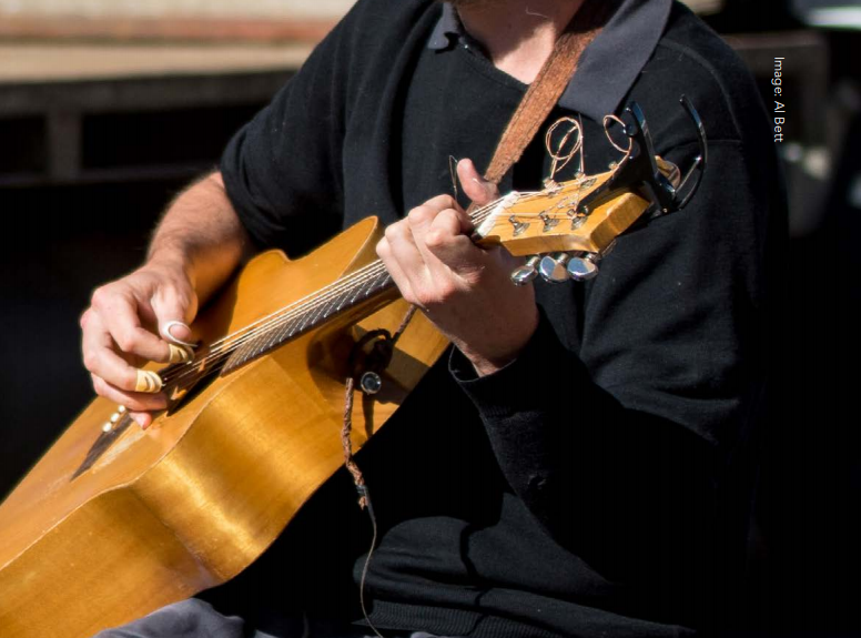 Busker playing the guitar