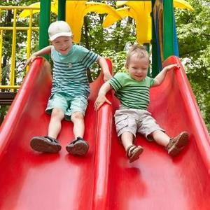 Shutterstock 391538869 children on slide