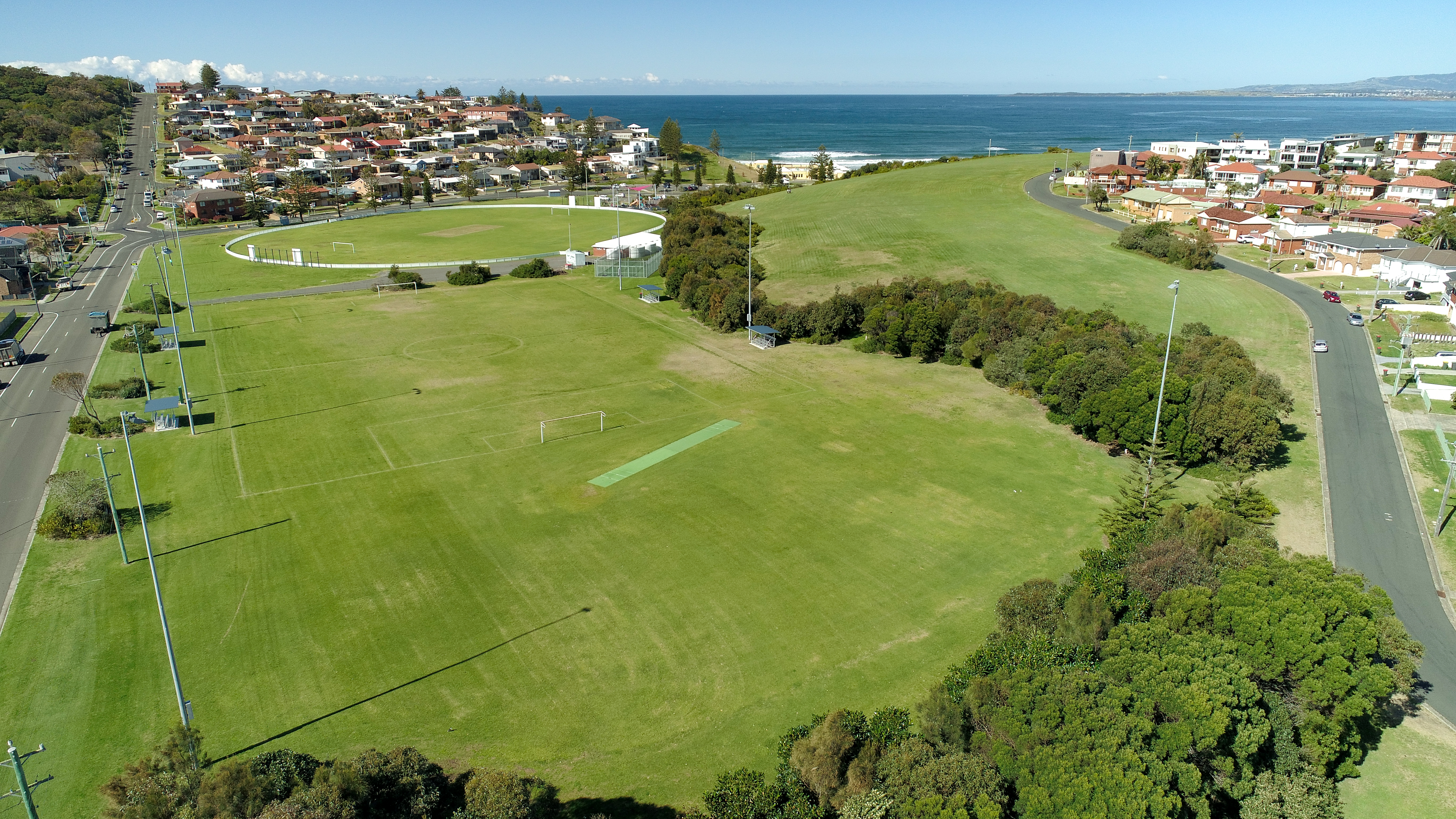 Image shows the King George V Oval in Port Kembla, looking out to the ocean.