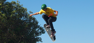 Skate image   boy with air and protective gear
