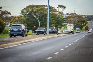 Cars and trucks travelling on the midland highway