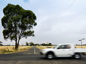 A ute driving on a country road