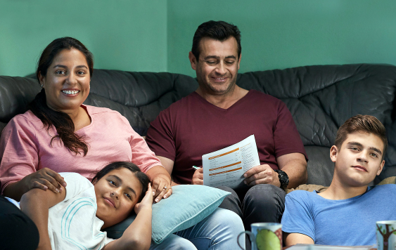 Cost of living hero image   family on couch