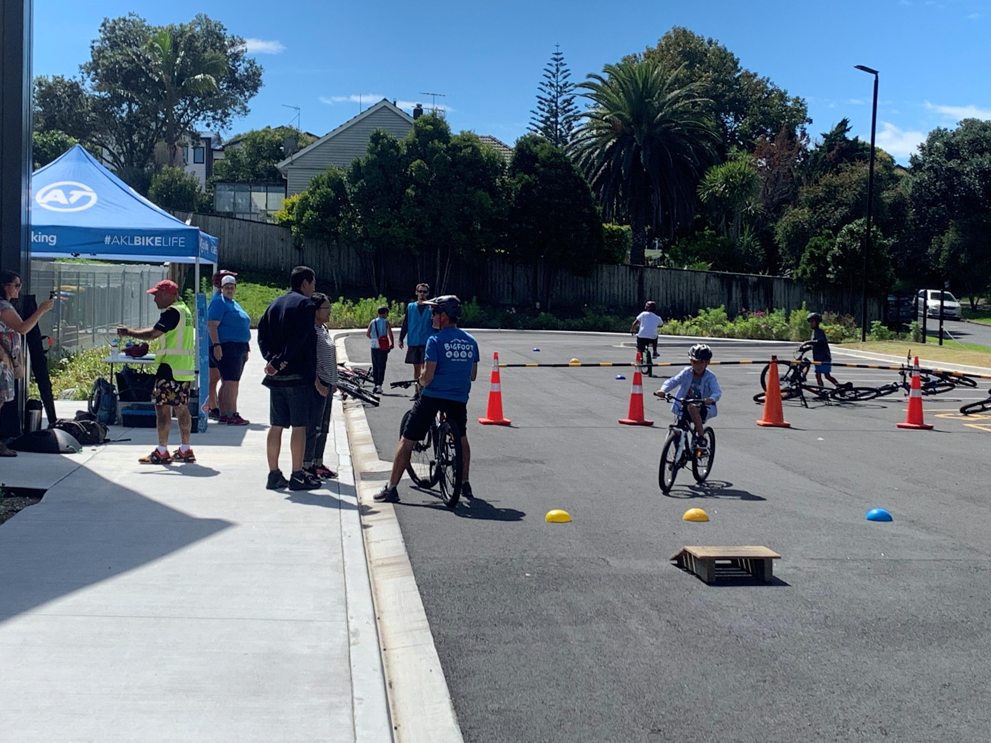 Bike skills workshop with children riding around on their bikes
