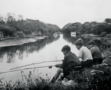 Old photo of boys fishing in the Otakaro Avon River