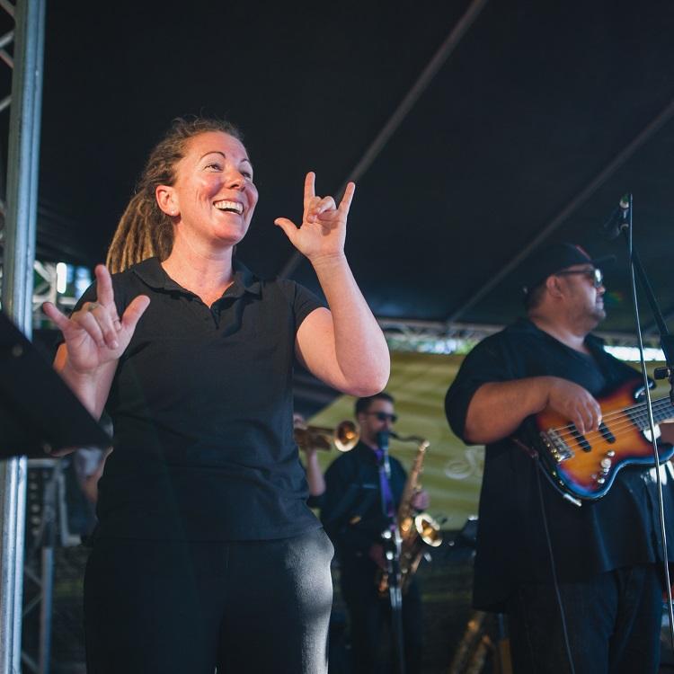 Auslan interpreter at a Sunset at Subi concert