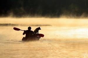 1_brett_dolsen_man_n_dog_in_boat