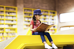 Child reading a book small