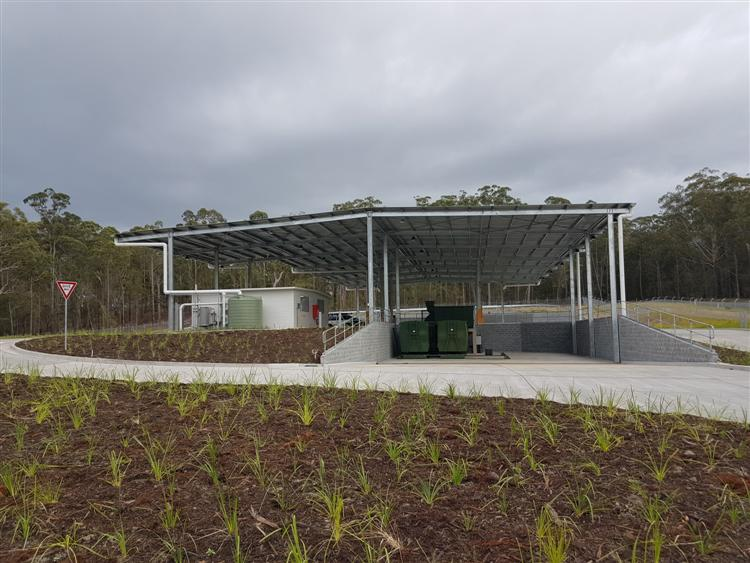 The brand new Kew Transfer Station. Concrete floor with huge aluminum veranda, with giant garbage bins.
