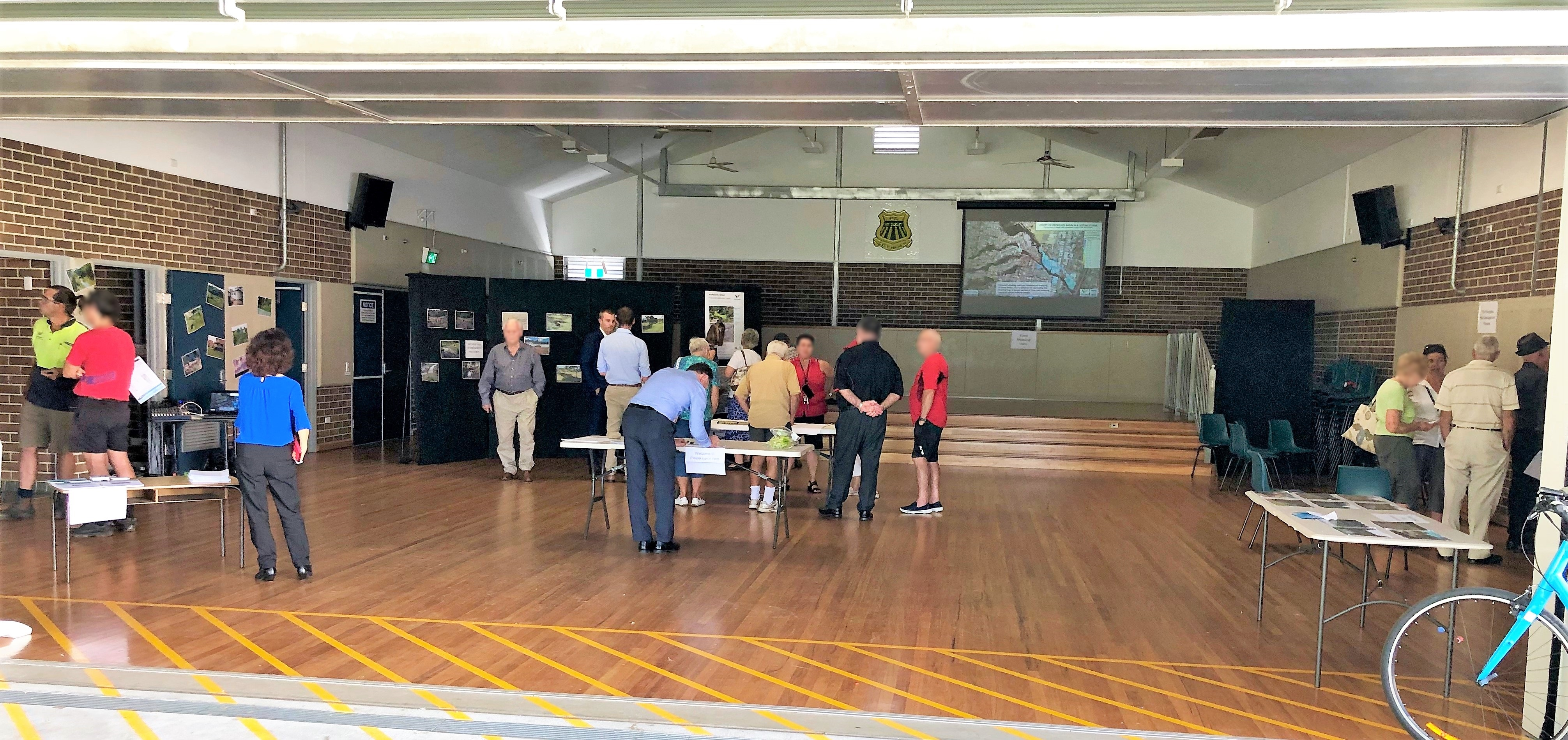 Community members attending the drop-in information session at Mount Ousley Public School