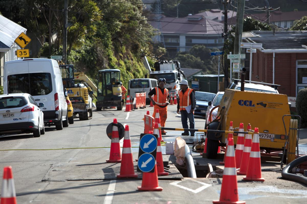 2 transport team members completing roadworks near Hanover Street, Wellington