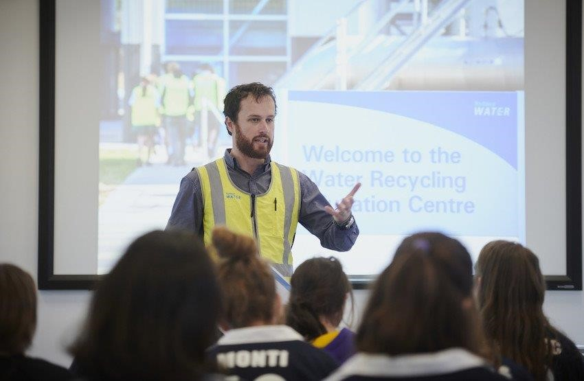 Sydney Water Education Officer presenting to crown of students
