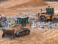 Bulldozers on landfill site