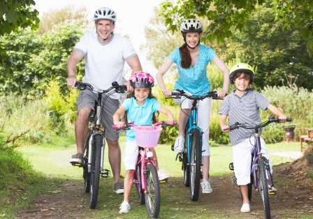 Copy of shutterstock 151807367 family cycling compressed