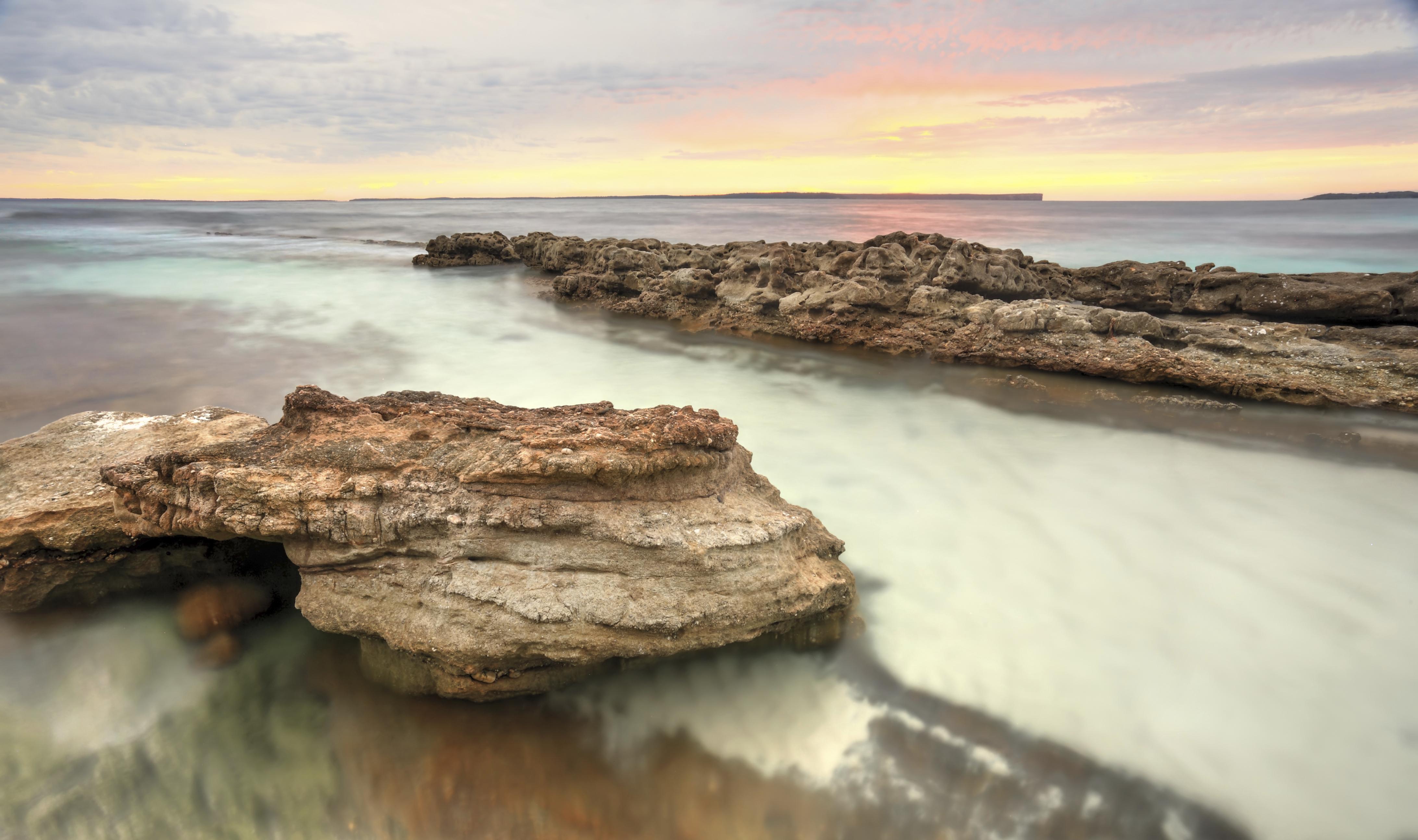 Soft pastel colours of a sunrise at hyams beach australia   istock 000044921584 large