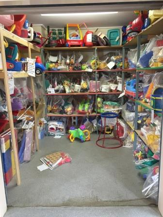 Photo storage cupboard with racks   large toys removed
