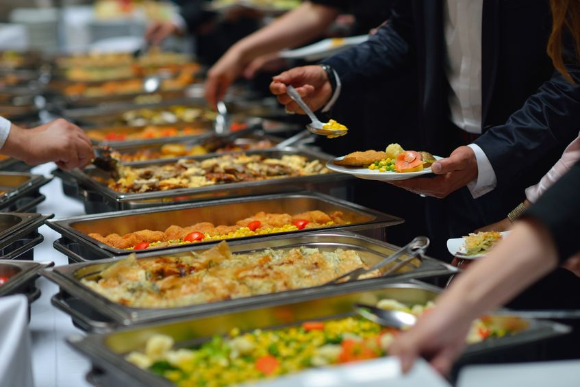 19774813 - people group catering buffet food indoor in luxury restaurant with meat colorful fruits  and vegetables