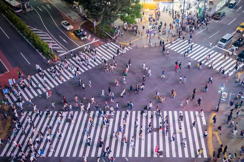 A busy intersection full of pedestrians